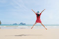 Happy woman Jump on the beach in Krabi Thailand Royalty Free Stock Images