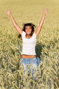Happy woman jump in corn field in summer Stock Images