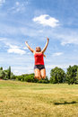 Happy woman jumping for achievement and success Royalty Free Stock Photo