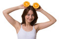 Happy woman keeps halfs of orange above on isolated white background Royalty Free Stock Photos
