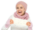 Happy woman in knit clothing holding air tickets Stock Image