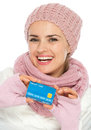 Happy woman in knit clothing showing credit card Stock Photography