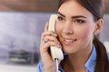 Happy woman on landline call young pretty phone smiling Stock Photography