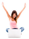 Happy woman with a laptop and arms up isolated over white background Royalty Free Stock Image