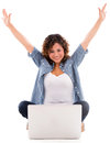 Happy woman with a laptop and arms up isolated over white background Royalty Free Stock Photo