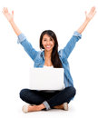 Happy woman with a laptop and arms up isolated over white background Royalty Free Stock Photography