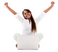 Happy woman with a laptop computer and arms up isolated over white Stock Photography