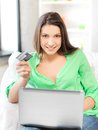 Happy woman with laptop computer and credit card picture of Royalty Free Stock Photo