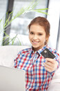 Happy woman with laptop computer and credit card picture of Stock Image