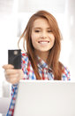 Happy woman with laptop computer and credit card picture of Royalty Free Stock Photos