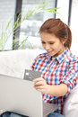 Happy woman with laptop computer and credit card picture of Stock Photo