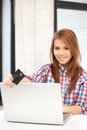 Happy woman with laptop computer and credit card picture of Stock Images
