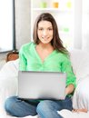 Happy woman with laptop computer picture of Stock Photos
