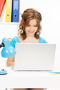 Happy woman with laptop computer picture of Stock Image
