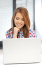 Happy woman with laptop computer picture of Royalty Free Stock Photography