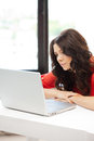 Happy woman with laptop computer picture of pensive Royalty Free Stock Photo