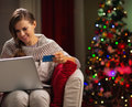 Happy woman with laptop and credit card Royalty Free Stock Images