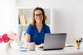 Happy woman with laptop working at home or office Royalty Free Stock Photo
