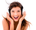 Happy woman listening to music with headphones – isolated over white Stock Images