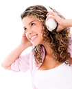 Happy woman listening to music with headphones isolated over white Royalty Free Stock Photo