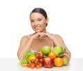 Happy woman with lot of fruits and vegetables picture Royalty Free Stock Photos
