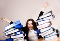 Happy woman with a lot of folders Royalty Free Stock Photos