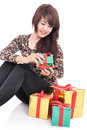 Happy woman with lots of gifts isolated on white background Stock Images