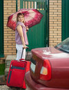 Happy woman with  luggage Royalty Free Stock Image
