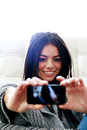 Happy woman making self photo with her smartphone young Royalty Free Stock Photo