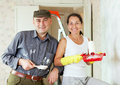 Happy woman and man makes repairs Stock Photography