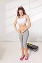 Happy woman measuring her waistline Royalty Free Stock Photo
