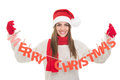 Happy woman with merry christmas text decoration young beautiful caucasian brunette wearing santa claus hat scarf and gloves Stock Photo