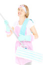 Happy woman with a mop picture of crazy playing over white background Stock Photo