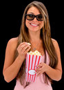 Happy woman at the movies wearing d glasses Royalty Free Stock Photo