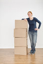 Happy Woman Moving In Stock Photo