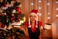 Happy woman near Christmas with open gift Stock Photo