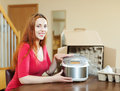 Happy woman with new slo cooker young at home Royalty Free Stock Image