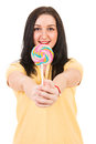 Happy woman offering lollipop big colorful isolated on white background Royalty Free Stock Image