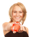 Happy woman offers gift box selective focus of young little red isolated on white background christmas surprise concept Royalty Free Stock Image