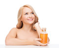 Happy woman with oil bottle health and beauty concept Royalty Free Stock Photo
