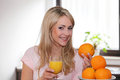 Happy woman with oranges and juice young fresh a glass of orange in her hand smiling at the camera conceptual of a healthy diet Royalty Free Stock Photo