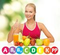 Happy woman with organic food and vitamins Royalty Free Stock Photo