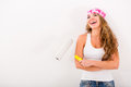 Happy woman painting her house Royalty Free Stock Photos