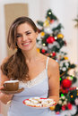 Happy woman in pajamas holding hot beverage Royalty Free Stock Photography