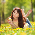 Happy woman with pear in the park Royalty Free Stock Photos