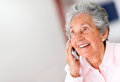 Happy woman on the phone portrait of a senior Royalty Free Stock Image