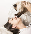 Happy woman playing with cat Royalty Free Stock Photo