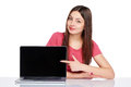 Happy woman pointing at a laptop computer screen Royalty Free Stock Photo
