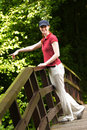 Happy Woman Pointing in the Park Stock Photo