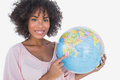 Happy woman pointing to globe on white background Royalty Free Stock Photography